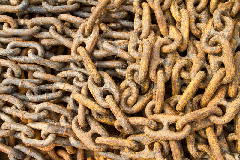 Rusty chain for mooring. In dockyard stock image