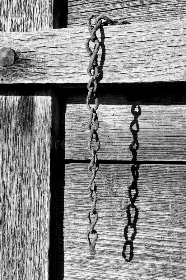 Rusty chain. Old and rusty chain in black and white stock photos