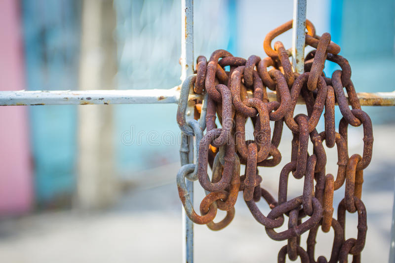 Rusty chains hanging doors. Background stock image