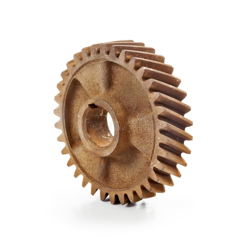 Rusty Cog Wheel. Old rusty cog gear wheel on white background royalty free stock photos