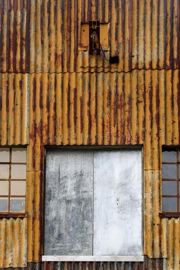 Rusty corrugated metal wall, with windows and doors, of an old building at the abandoned Grytviken whaling station. On South Georgia, Antarctica stock photos