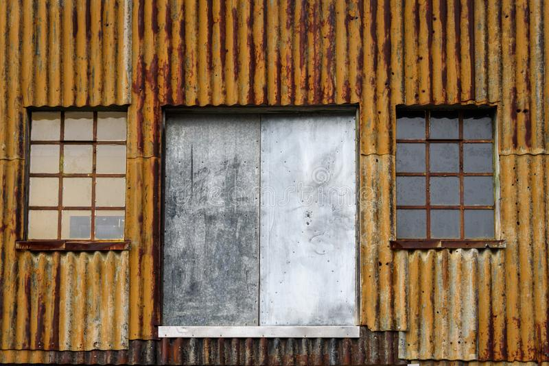 Rusty corrugated metal wall, with windows and doors, of an old building at the abandoned Grytviken whaling station. On South Georgia, Antarctica stock images