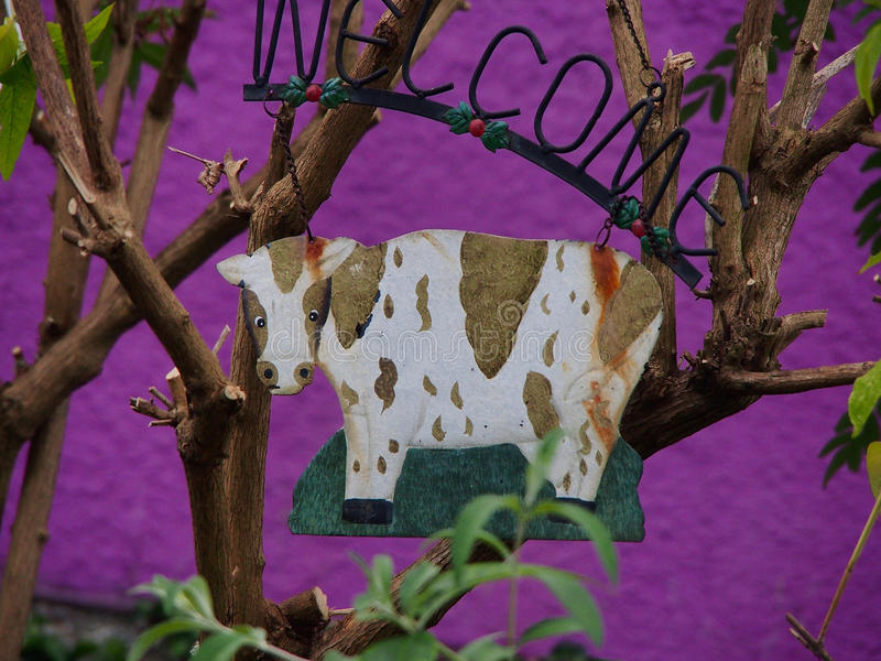 Rusty the cow in garden royalty free stock photography