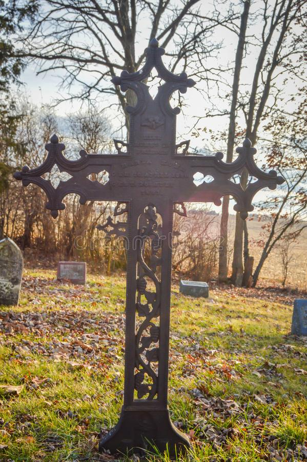 Rusty Cross with Tree Branches in cemetery royalty free stock photos