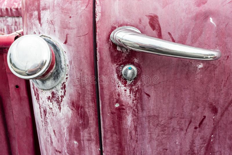 Rusty door handle and gas cap. royalty free stock photography