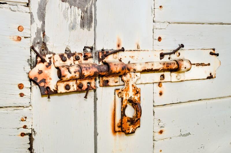 Rusty door handles on wooden door stock photography