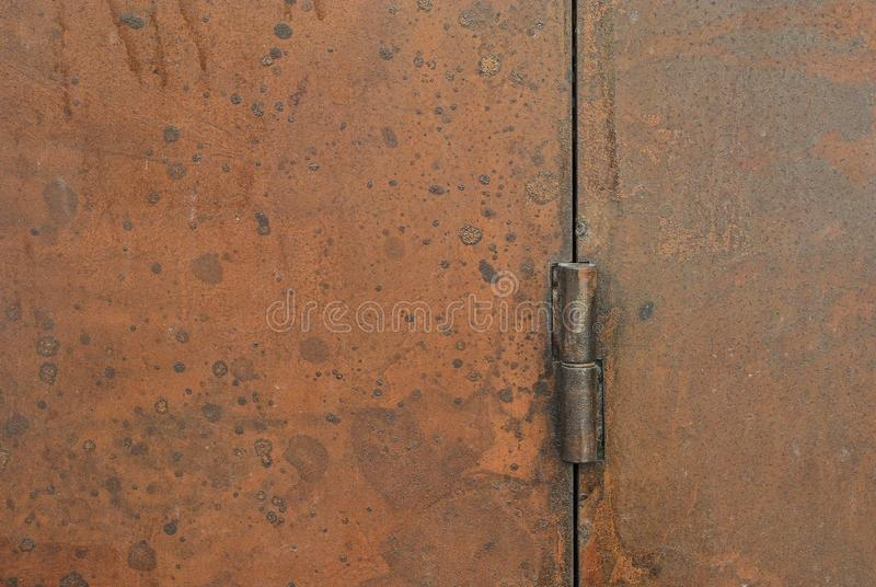 Rusty door hinge, exterior decoration and industrial construction concept design. royalty free stock photography