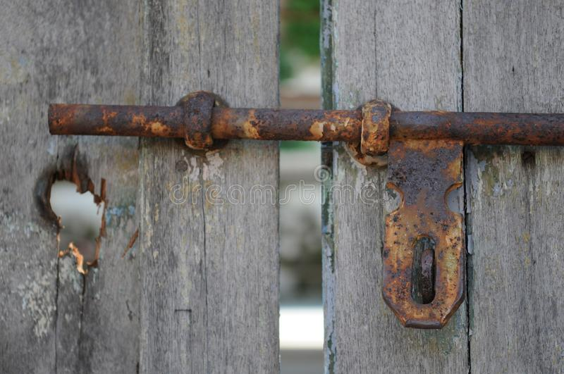 Rusty door lock on wooden door royalty free stock photography