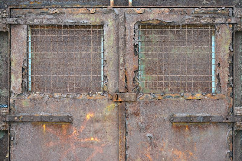 Rusty doors. Rusty metal doors locked shut, Newhaven, UK royalty free stock photography