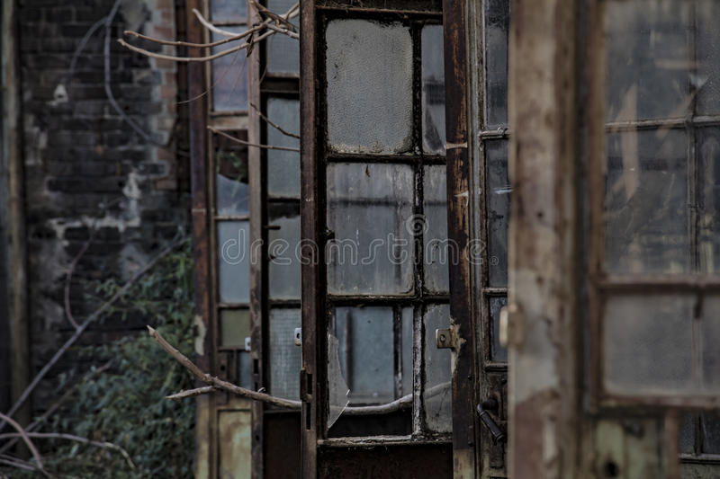 Rusty doors of an old, abandoned industrial facility. In a row stock photography
