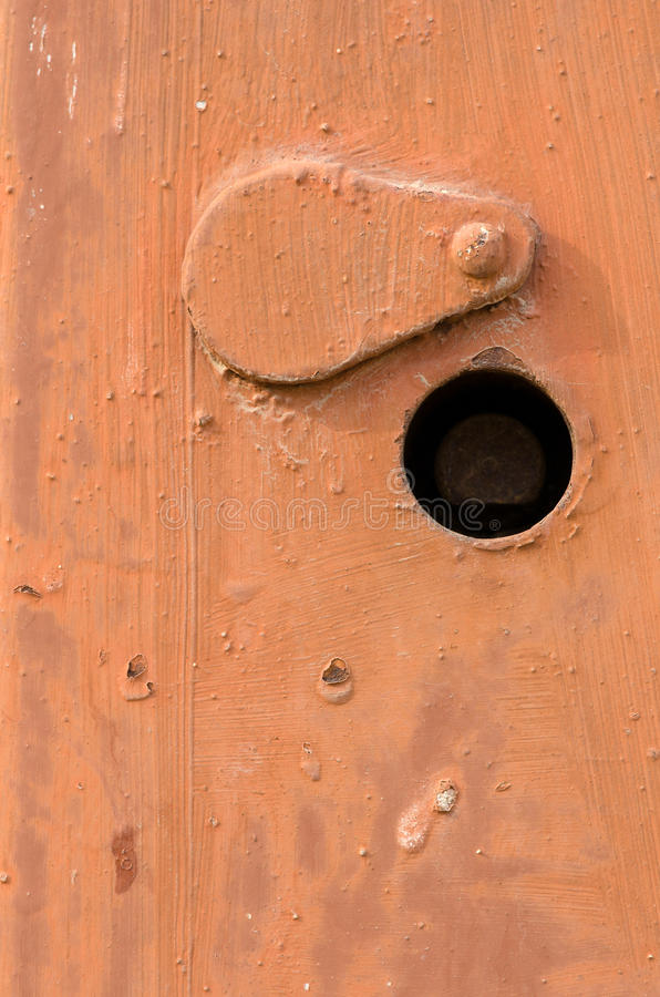 Rusty doors. Orange rusty doors texture. Switchboard cover with keyhole stock image