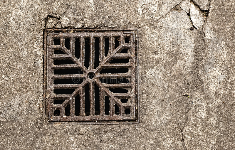 Rusty drain grate. royalty free stock images