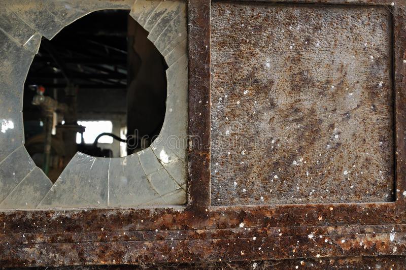 Download Rusty Factory Door And Smashed Glass Stock Photo - Image of dusty, moody: 23502556