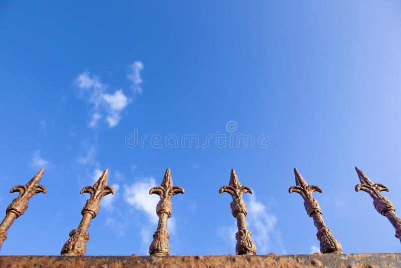 Rusty fence. Under blue sky stock photo