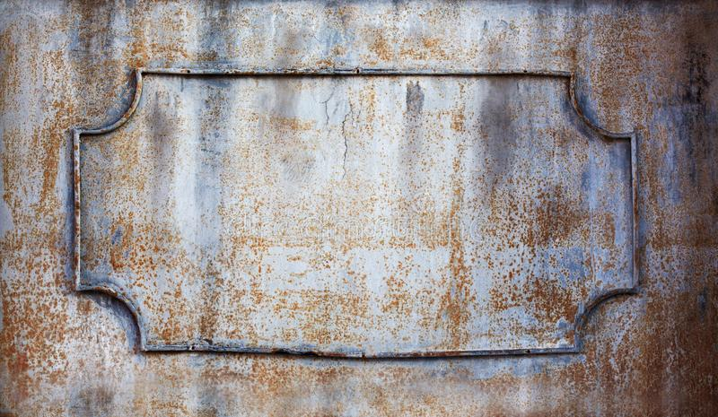 Rusty frame with decorative forged iron elements. Copy space sgallow depth of field stock photography