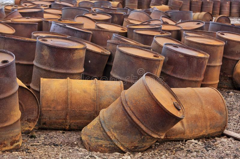 Rusty fuel drums on Arctic coast stock images