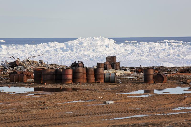 Rusty fuel drums on Arctic coast royalty free stock images