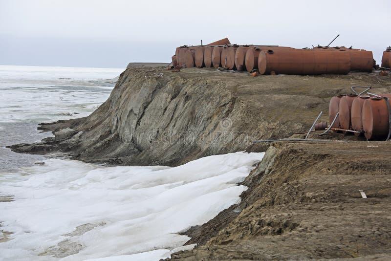 Rusty fuel storage tanks in Arctica stock photos