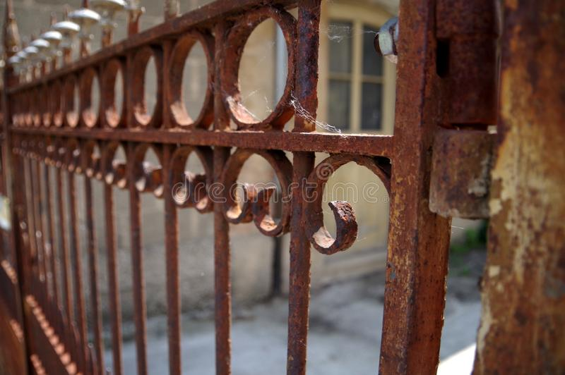 Nicely decorated garage door made of rusty steel stock photos