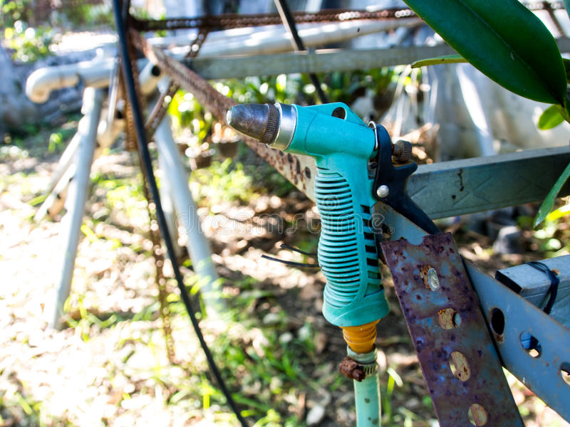Rusty Garden Hose Sprayer royalty free stock images