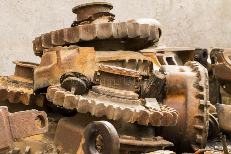 Rusty gears. Rusty cogs in junkyard as background royalty free stock images