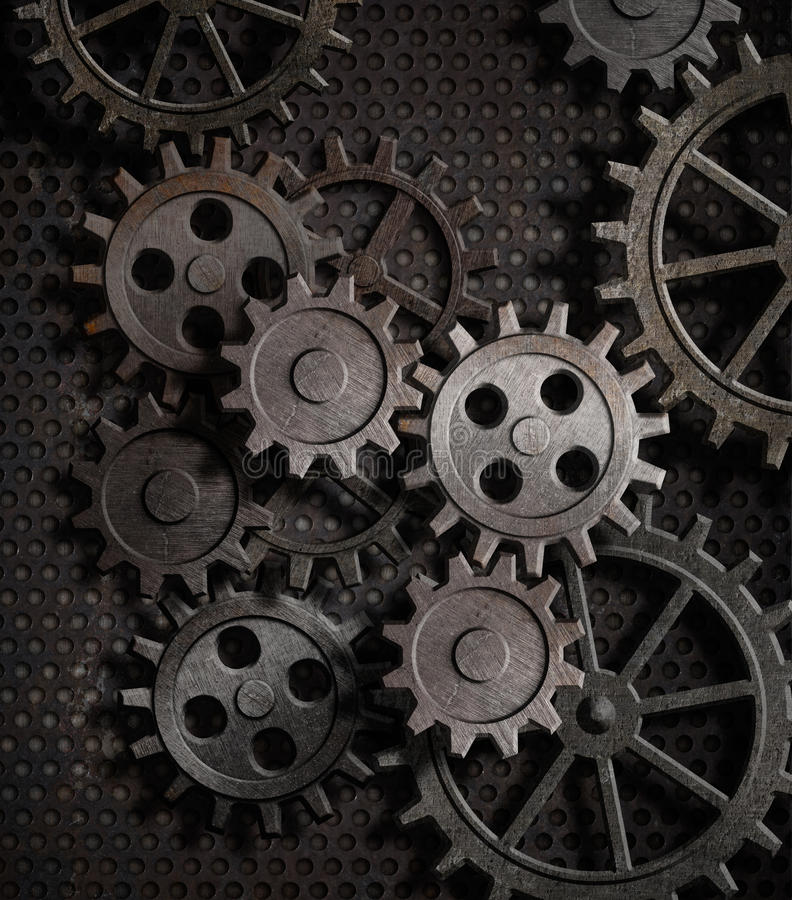 Rusty gears and cogs metal background. Rusty gears old clockworks metal background royalty free stock photos