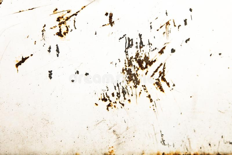 Rusty and grungy white painted metal iron plate wall with weathered peeling coating stock images
