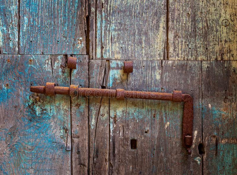 Rusty horizontal lag bolt on weathered wooden door. Rusty horizontal lag bolt on weathered, old wooden door royalty free stock photos
