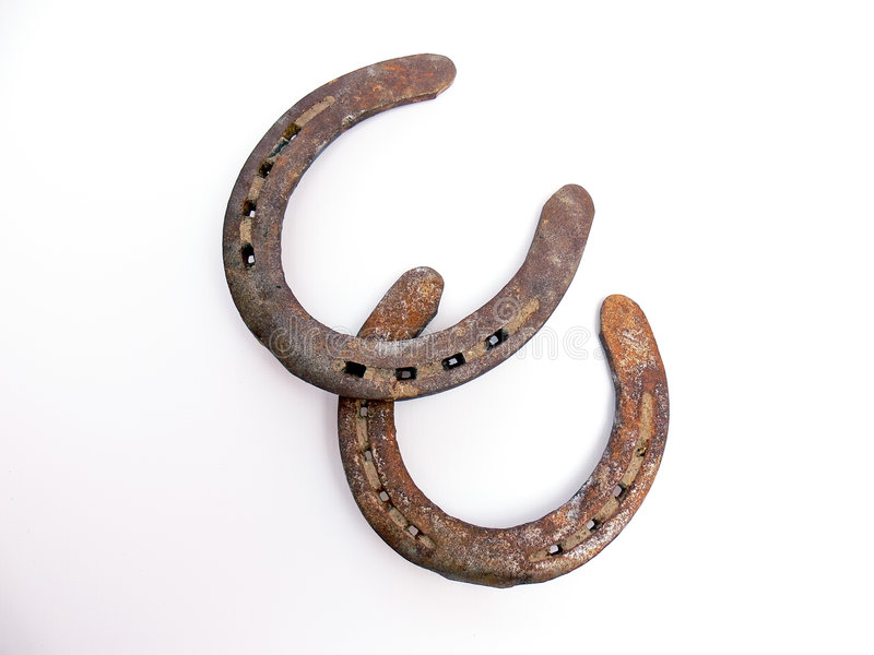 Rusty horseshoes. Two rusty horseshoes isolated on white background stock photography