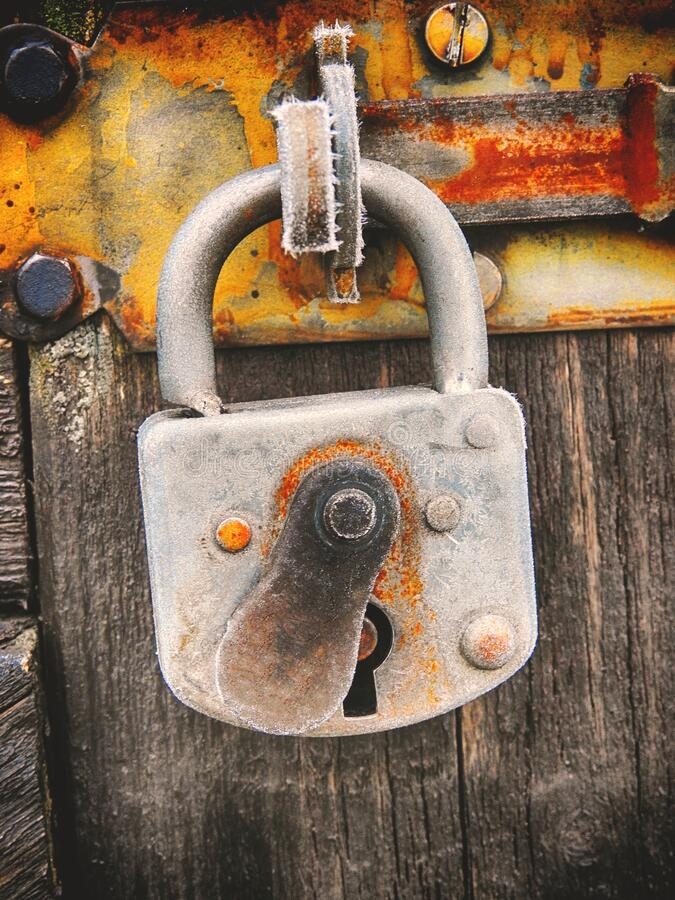 Rusty and icy lock. Closeup royalty free stock photography