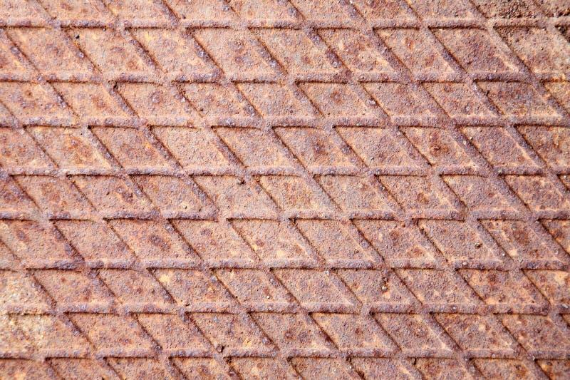 Rusty industrial metal floor stock photography