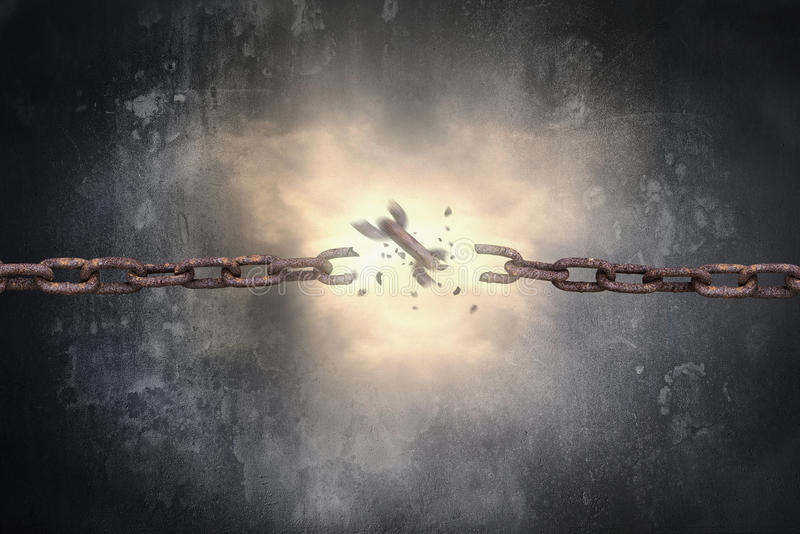 Rusty iron chains broken with spark light and dark wall royalty free stock images