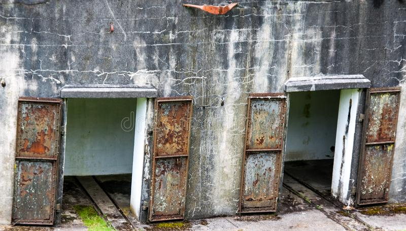 Rusty Iron doors on a concrete wall. Rusty Iron doors on a World War 2 bunker monument royalty free stock photos