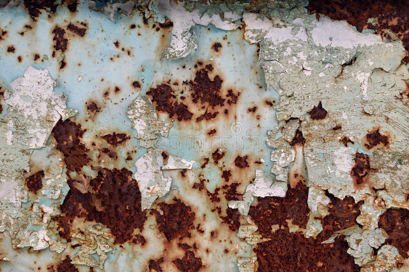 Rusty iron. Old worn metal surface with paint. Texture. Background. White paint in the cracks and rust. Attrition. Corrosion. Oxidation stock images