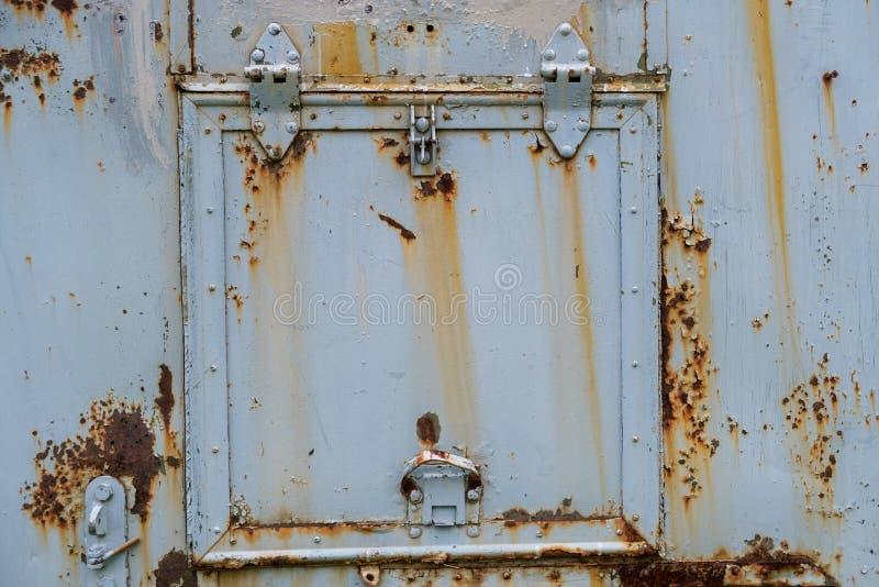 Rusty iron square door in a car van stock photos