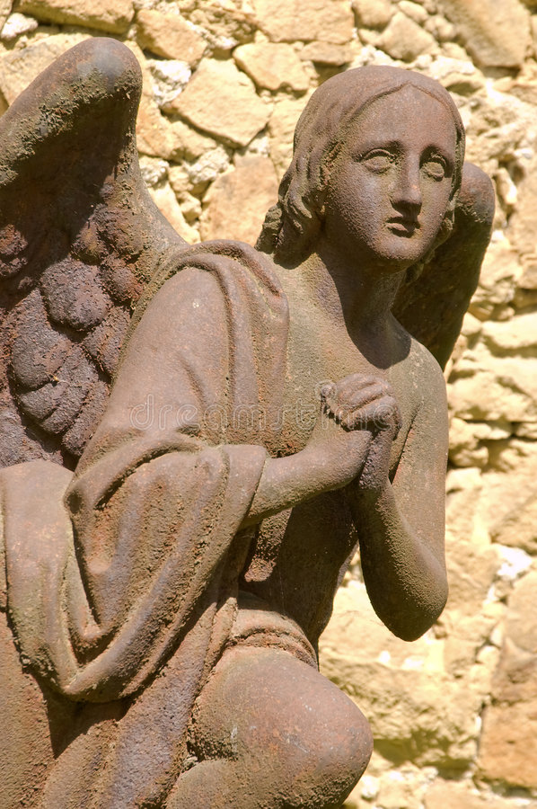 Rusty iron statue of angel. Statue of angel. Rusty iron sculpture from cemetery stock photos