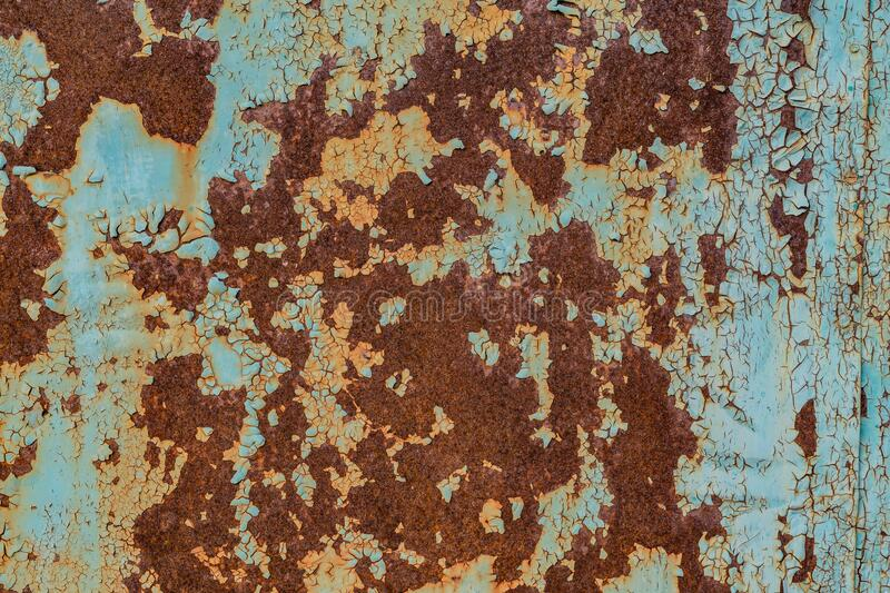 Rusty iron, texture on old metal surface. Old cracked and flaked paint. Background, texture royalty free stock images