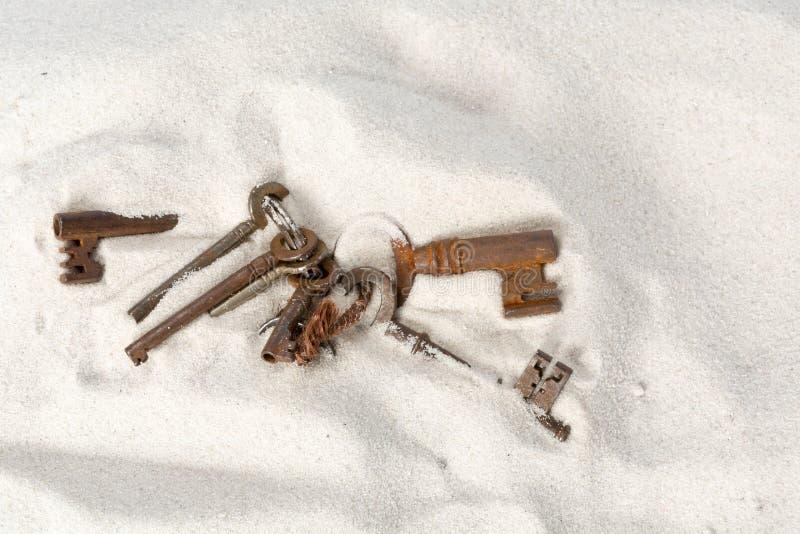 Rusty keys on the beach royalty free stock photography