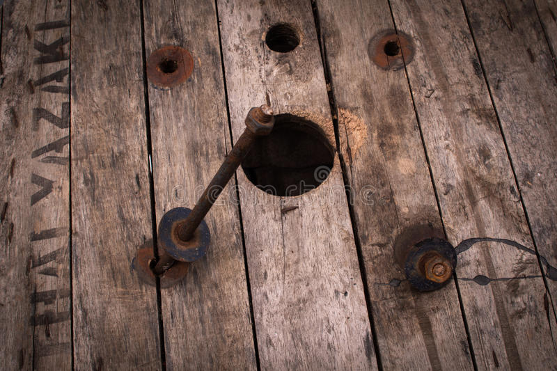 A rusty knot attached in a wood. stock images