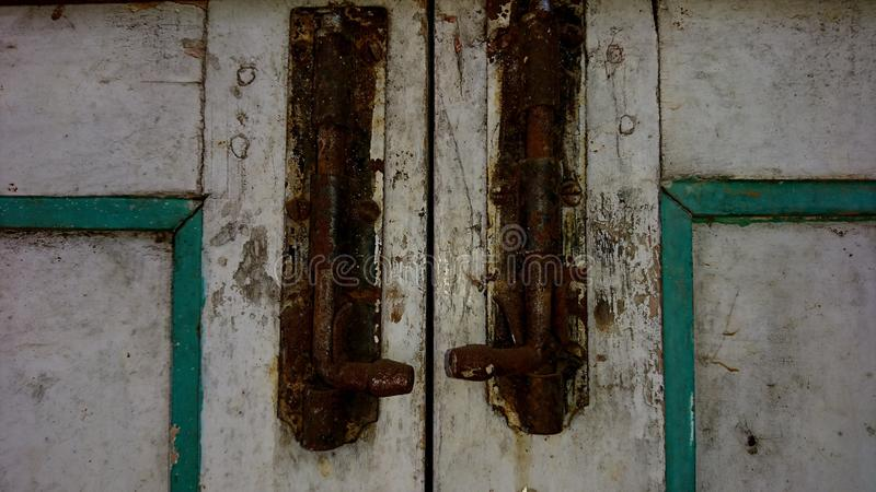 Rusty latch on the door stock image