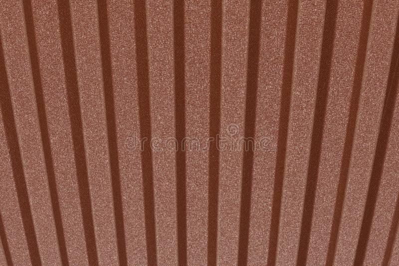 Rusty linear brown wall. Brown metal fence. Abstract linear background. Sunny day. Rusty wall royalty free stock images