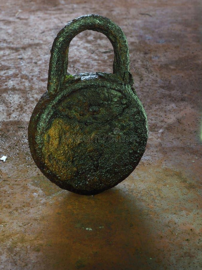 Rusty lock on a rusty table stock photo