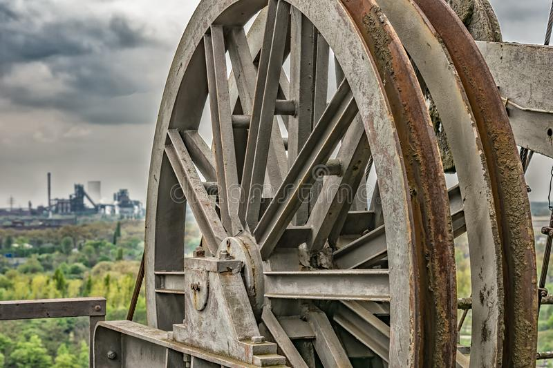 Rusty machinery wheel outdoors