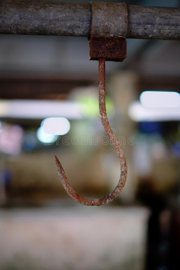 Old rusty meat hook hanging at abandoned wet market. royalty free stock photos