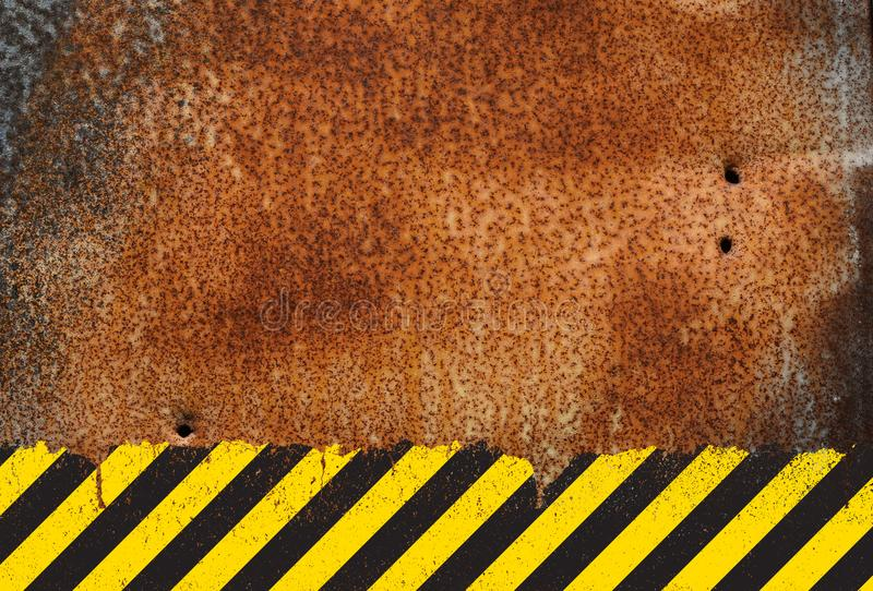 Rusty metal background with grunge hazard sign stock photography