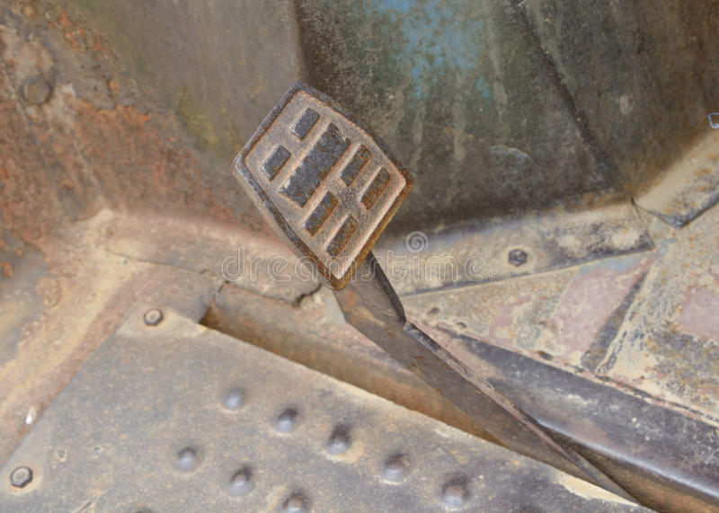 Rusty metal brake pedal. Metal brake pedal vintage tractor, with metal surface rust spots stock photo