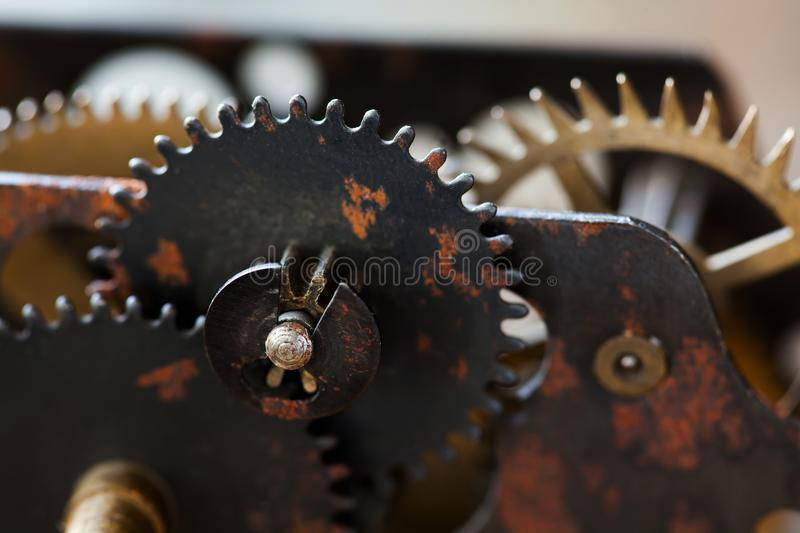 Rusty metal clock mechanism cog gears connection concept. Black iron wheels industrial still life photo. Macro view stock photo