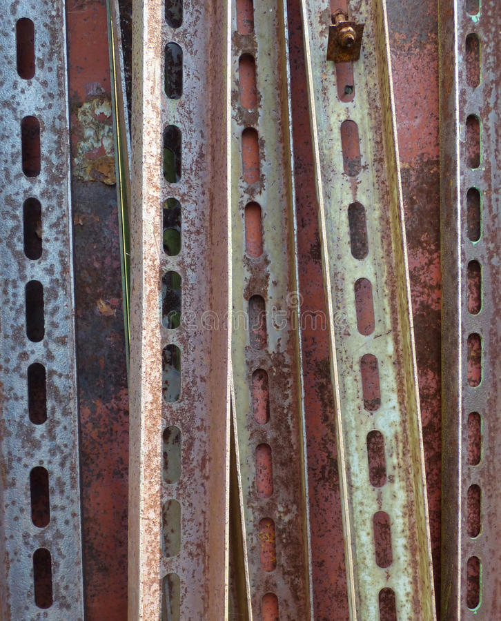 Rusty metal corners with perforation. Industrial background. Aged rusty vertical metal corners with perforation. Industrial background stock photo