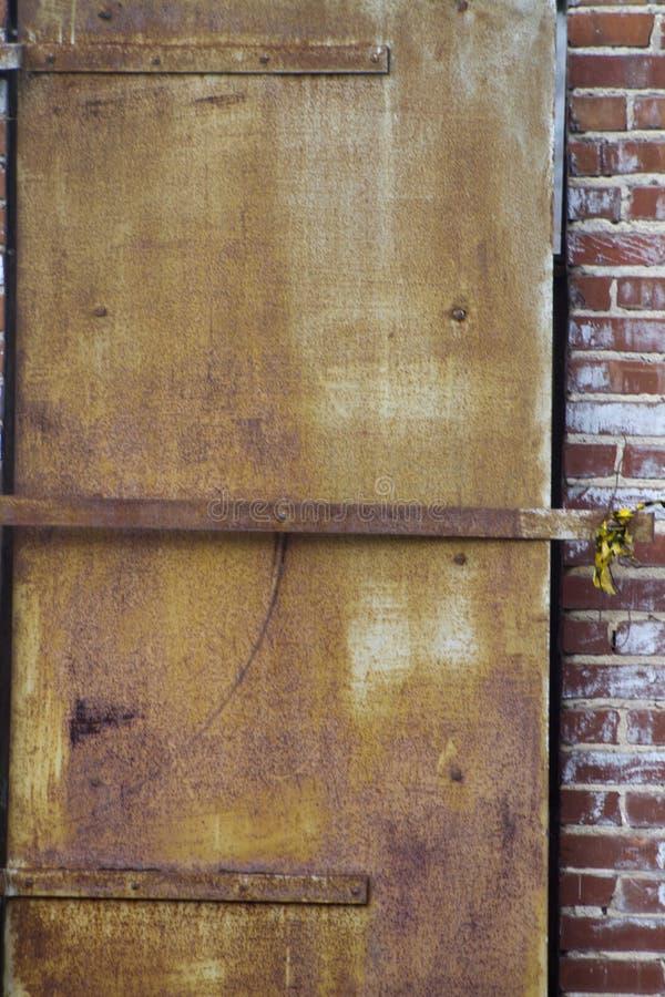 Rusty Metal Door Grunge Texture Background royalty free stock photos