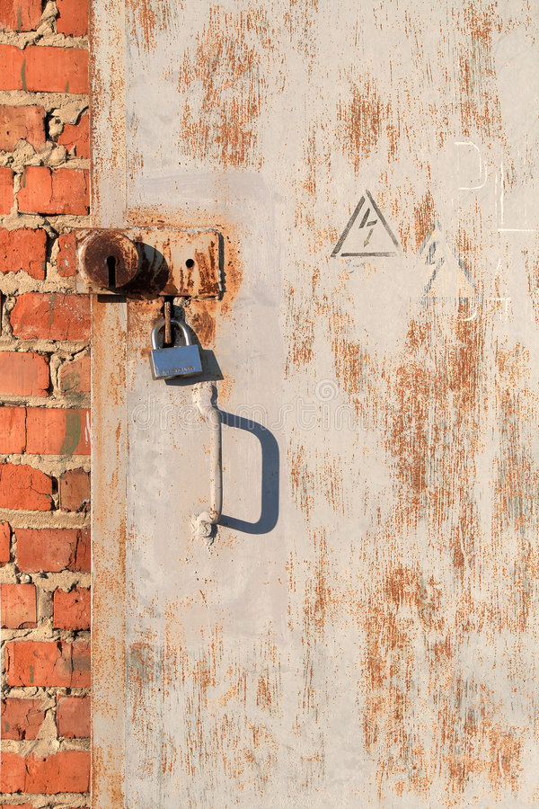 Rusty Metal Door With The Lock Royalty Free Stock Photos